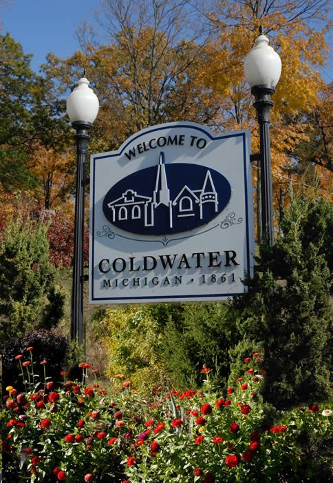 The Welcome to Coldwater Sign surrounded by trees